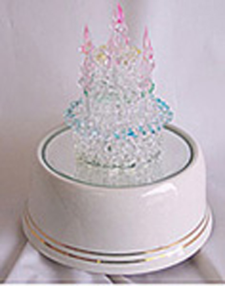 Birthday cake that rotates and plays music.